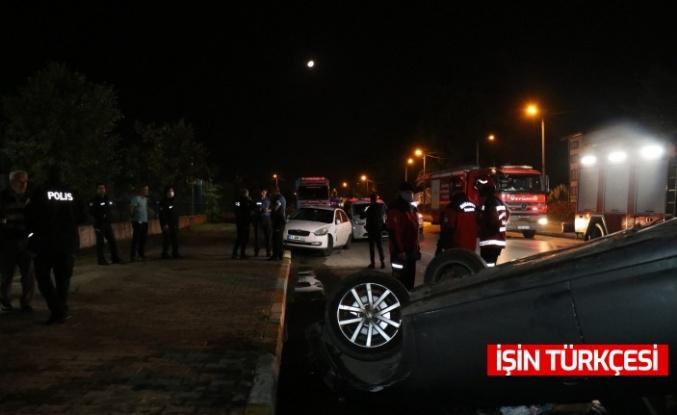 Arifiye'de kontrolden çıkan otomobil, park halindeki araca çarparak takla attı